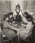 Government hotel for Negro women war workers; A group of young war worker-residents are shown enjoying a game of cards in the fully equipped game room of the Lucy D. Slowe Residence Hall, first government constructed hotels for Negro women war workers in Washington, D.C., between Fall 1942 and April 1943