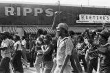 African American protestors at a United Klans of America march in Mobile, Alabama.