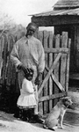 A French - speaking Louisiana Negro and his grandchild