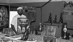 Man posing with Egyptian objects, Los Angeles, 1986