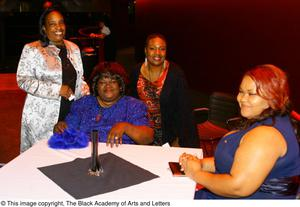 Women sitting at table Hip Hop Broadway: The Musical