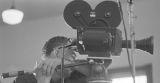 Cameraman filming Martin Luther King, Jr., speak at Maggie Street Baptist Church in Montgomery, Alabama.