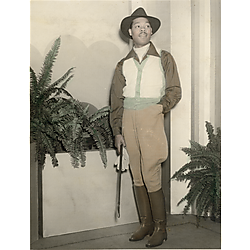 Fashion model Louie Smith wearing jodphers holding gloves and crop