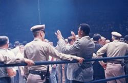 Cassius Clay haranguing Sonny Liston at ringside after Liston knocked out Floyd Patterson, July 22, 1963