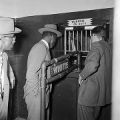 Two African American men in a segregated line at a counter, possibly at a jail in Birmingham, Alabama.