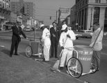 Sanitation crew sweeping up trash in Court Square at Commerce Street in Montgomery, Alabama.