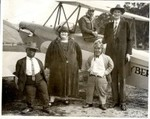Two Little People, One Lady, One Man, Pilot and Biplane