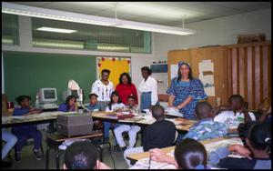 Women and Students in Gates Elementary Classroom San Antonio Chapter of Links Records