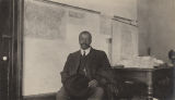 African American man, probably a teacher, seated in a classroom in rural Pickens County, Alabama.