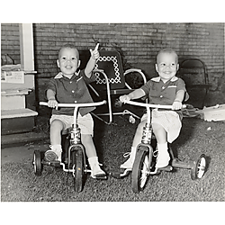 Two boys on tricycles