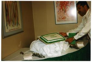 Man Arranging Cake at Service to Youth Award Program San Antonio Chapter of Links Records