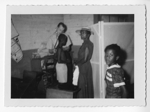Photograph of a white doctor examining an African American boy, Clarkesville, Habersham County, Georgia, 1953