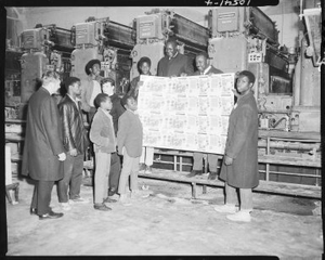 Brown Paper Company, boys from Hurd School viewing printed sheet in front of large printing press