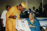 Eugene Redmond presenting a card to Katherine Dunham (2 of 2)