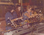 Workers on the shop floor at a National Industries plant, probably in Jackson, Mississippi.