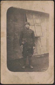 [Unidentified African American soldier in uniform, unofficial cap, and cartridge belt with revolver]