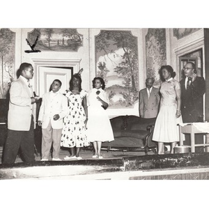 Unknown individuals performing in a community play at the Norfolk House.