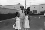 Donald Bohana posing with his daughters, Los Angeles