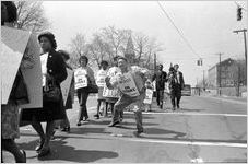 """Sanitation workers strike supporters marching in downtown Atlanta, Georgia, March 28, 1970. Photograph is part of a series labeled """"Strike march."""""""