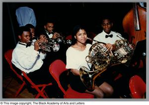 Photograph of students with french horns and trumpets Christmas/Kwanzaa Concert Hallelujah Hip Hop Concert, December 1995
