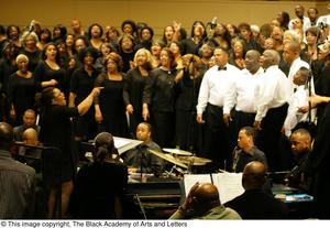 Band and choir on stage Black Music and the Civil Rights Movement Concert, featuring Chrisette Michele and Ledisi.