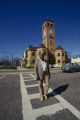 Lucius Amerson, former sheriff of Macon County, Alabama, crossing the street in front of the courthouse in downtown Tuskegee.