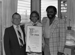 Taylor Billingslea posing with others in his office, Los Angeles, 1983
