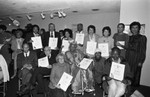 California African American Museum guests holding commendations, Los Angeles, 1983