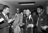 Martin Luther King Jr. speaking with a reporter at the Montgomery County courthouse after a meeting with local officials in Montgomery, Alabama.