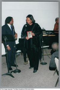 Curtis King and unidentified woman Christmas/Kwanzaa Soiree