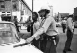 Thumbnail for Police officers arresting Mattie Howard during the Children's Crusade in Birmingham, Alabama.