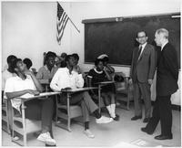 A group of students sit in a classroom.