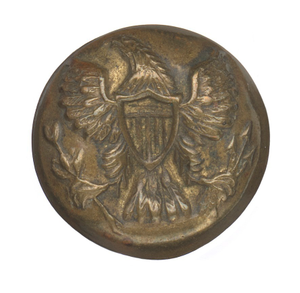 Stamped brass uniform button with American eagle