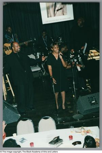 Photograph of Sandra Kaye and a band performing on stage Al Lipscomb Tribute