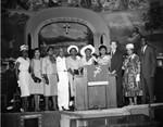 Men and women at podium, Los Angeles, ca. 1960