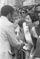 """Andrew Young shaking hands with a woman in a crowd in downtown Atlanta, Georgia, during the Democratic National Committee's regional conference, """"Victory '68."""""""