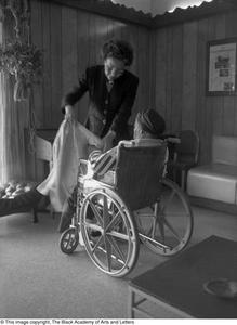 Tiny Hawkins helping a woman in a wheel chair Dallas/Fort Worth Black Living Legends Dallas/Fort Worth Black Living Legends, 1991