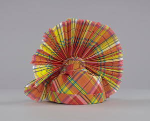 Red, yellow, blue, and white Madras headdress