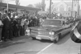 Car moving down the street during Martin Luther King, Jr.'s funeral procession.