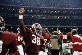 Alabama Fullback Charlie Williams (#38) with teammates after the 1980 Sugar Bowl game at the Superdome in New Orleans, Louisiana.