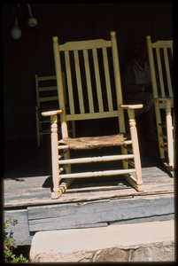 Rural crafts: Johnnie Ree Jackson. Wooden chair with animal hide seat