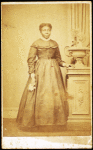 Studio portrait of unidentified woman holding handkerchief