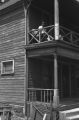 Jasper Wood Collection: Man sitting on second floor porch