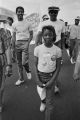 Young girl participating in the 20th anniversary reenactment of the Selma to Montgomery March, probably in rural Dallas or Lowndes County, Alabama.