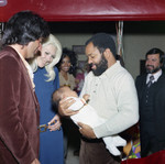 Berry Gordy holding a baby, Los Angeles, 1971
