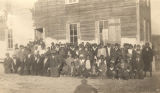 African American students and teachers gathered outside a rural school building in Evergreen, Alabama.