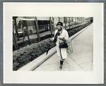 Woman walking along sidewalk