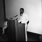 African American man speaking at a lectern, Los Angeles, 1972