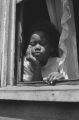 Jasper Wood Collection: Close-up of girl in window