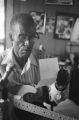 "James ""Son"" Thomas, reading note at home, Leland, Miss. (JTP 30-77-8)"
